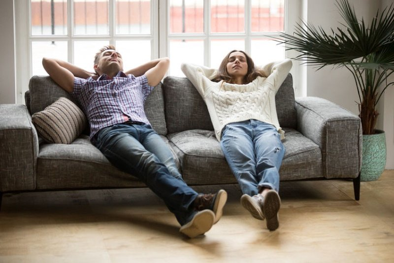 Young couple relaxing while doing manifestation meditation