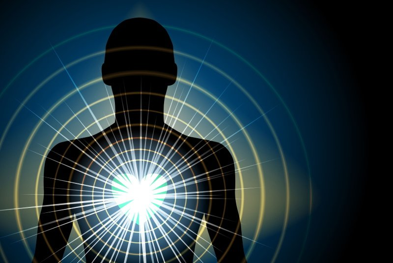 Human Silhouette With Energy Radiating From Heart Chakra